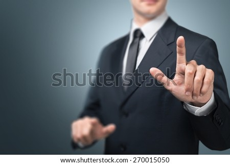 Business. Businessman hand touch blue  gear to success concept - stock photo