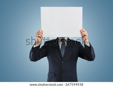 Business. Businessman holds a paper with a smile - stock photo