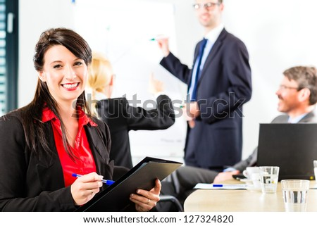 Business - businesspeople have a meeting with presentation in office, they negotiate a contract - Portrait of a businesswoman - stock photo