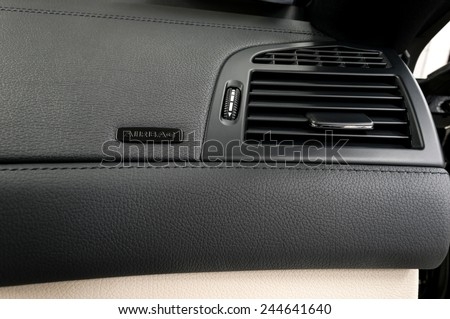 Business car airbag panel and air conditioning hole. - stock photo