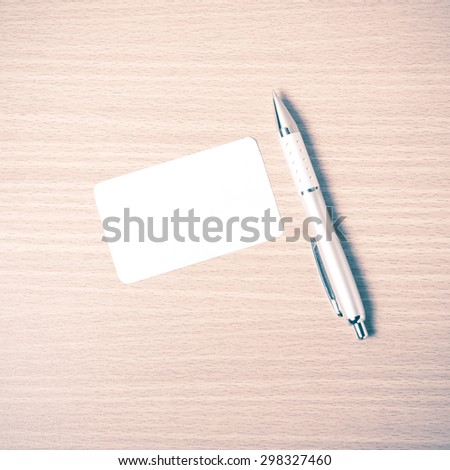 business card and pen on wood background vintage style