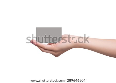 Business card lays on a female hand - stock photo