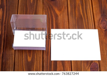 Business card on a wooden background