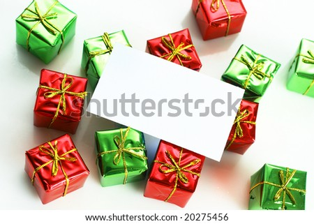 Business card on little red and green gifts - stock photo