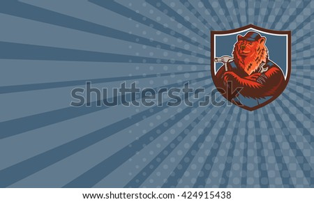 Business card showing illustration of a builder handyman Russian bear or Eurasian brown bear wearing hat arms folded tools hammer and wrench facing front set inside crest shield retro woodcut style.  - stock photo