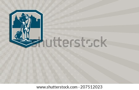 Business card showing illustration of a janitor carpet cleaner worker vacuuming with vacuum cleaner carpet cleaning machine viewed from front with buildings set inside shield done in retro style.