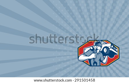 Business card showing illustration of an automotive mechanic carrying pick-up truck car vehicle on shoulder holding spanner wrench done in retro style. - stock photo