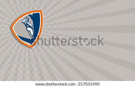 Business card showing illustration of lumberjack arborist tree surgeon holding a chainsaw climbing up a tree set inside shield shape on isolated white background. - stock photo