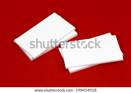 Business card template mockup for branding identity or contact information drawing. Ready to print modern abstract design or hipster logo. Isolated on red paper background.