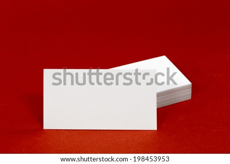 Business card template mockup for branding identity with blank modern devices and modern abstract or hipster logo print. Isolated on red paper background.