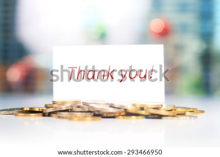 Business card. Thank you card and coins on a table. - stock photo