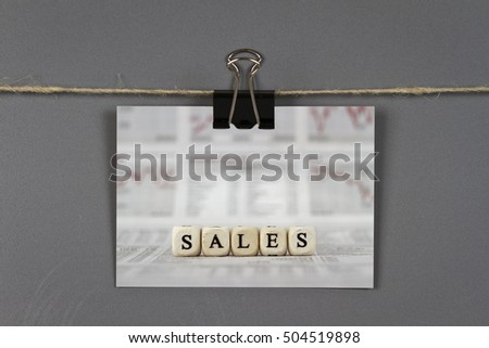 Business card with SALES word on a pinboard