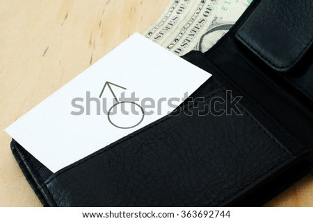 Business card with the sign MALE SEX in wallet with dollars  - stock photo