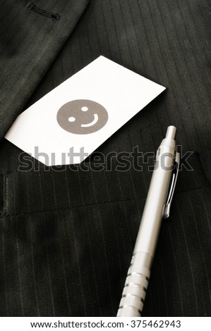 Business card with the sign SMILEY