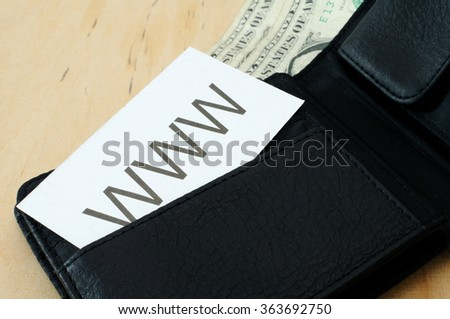 Business card with the sign WWW in wallet with dollars  - stock photo
