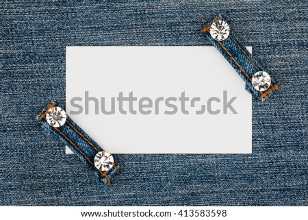 Business card with two straps  jeans, lies on the light denim, with space for your text - stock photo