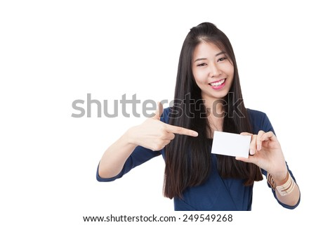 Business card woman. Portrait of a young beautiful businesswoman holding a blank white paper sign. Mixed race Asian / caucasian woman isolated on seamless white background. - stock photo
