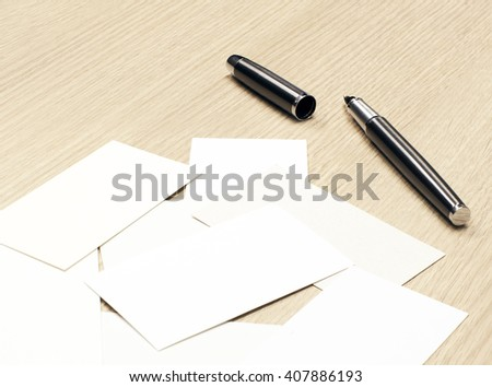 Business cards and pen on the table