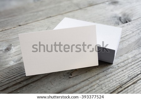 Business cards blank mockup on wooden background - stock photo