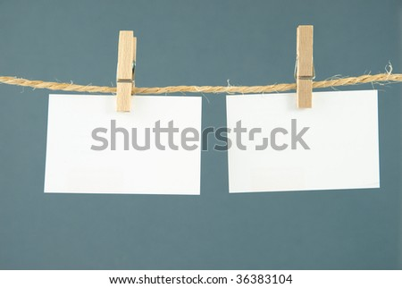 Business cards on clothesline