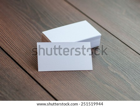 Business cards on wooden background - stock photo