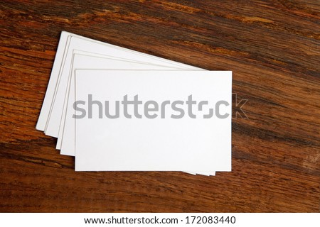 Business cards on wooden table - stock photo