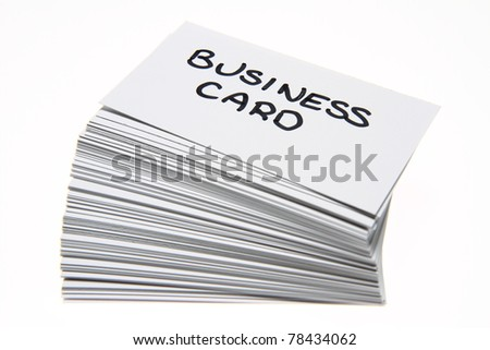 Business cards with 'business card' handwritten on the top one