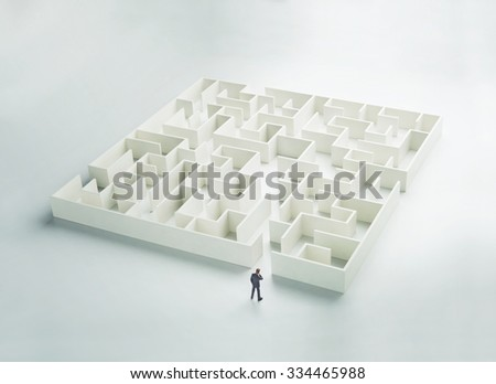 Business challenge. A businessman at the entrance to a maze. Rear view - stock photo