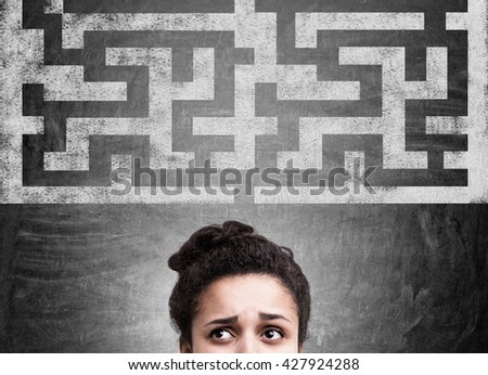 Business challenge concept with confused african american businesswoman and maze sketch on chalkboard - stock photo
