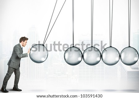 Business challenge concept with Newton cradle - stock photo