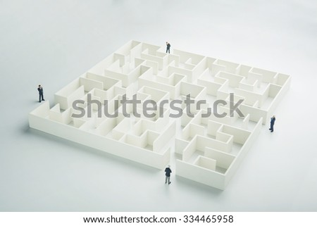 Business challenge. Four businessmen at the entrance to a maze - stock photo