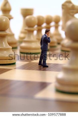 Business character contemplating strategy. - stock photo