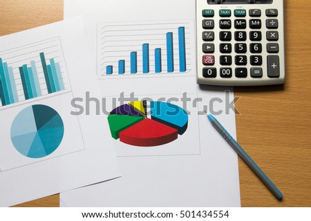 Business chart and graph with pen, calculator