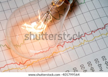 business chart and light bulb, business idea concept. - stock photo