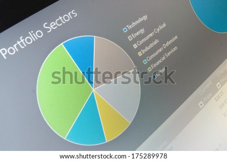 Business chart data diagram on computer screen.  Shallow depth of field photo  - stock photo