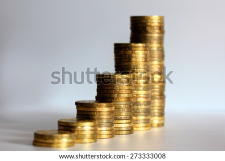 Business chart is made from golden coins, shows an increase