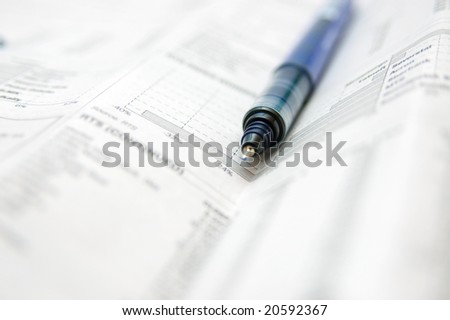 Business chart.Newspaper and pen