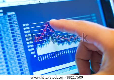business chart on a touch screen tablet-pc - stock photo