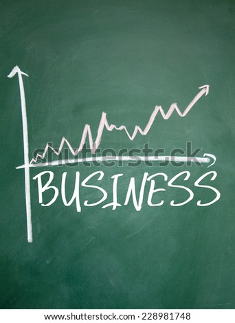 business chart on blackboard - stock photo