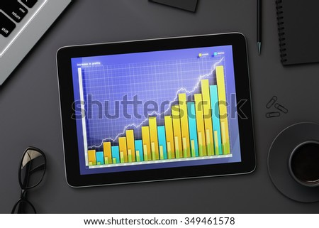 Business chart on digital tablet screen with eyeglasses and coffee mug on black table 3D Render