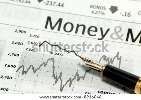 business chart with pen - stock photo