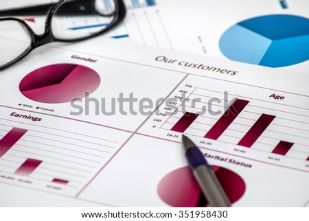 Business chart with pen and glasses