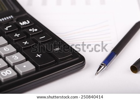 Business Charts with calculator and pen on white background - stock photo