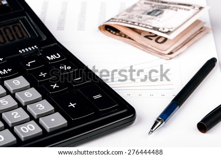 Business Charts with calculator, dollars money and pen on white background - stock photo