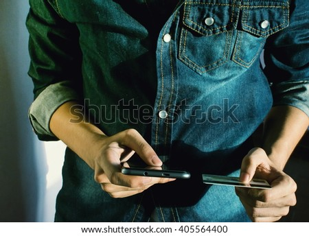 Business Checking the transfer payment With  holding a credit card And Mobile Phone In Morning - stock photo