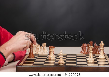 Business Checkmate. Businessman playing chess.