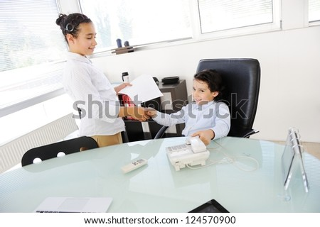 Business children working as real adult people at office - stock photo