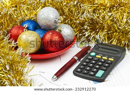 Business Christmas of red balls, pen, calculator, tinsel, saucer - stock photo