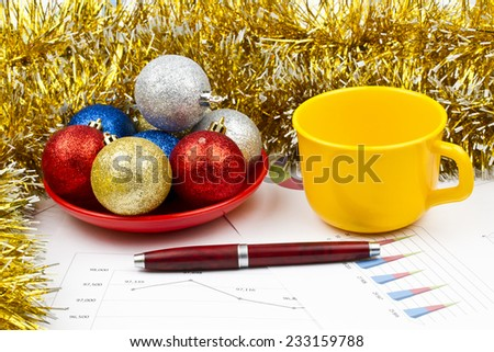 Business Christmas of red balls, pen, cup, tinsel, saucer - stock photo