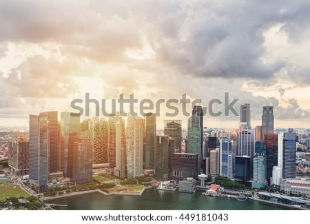 Business city urban skyline sunset. Singapore skyscrapers in downtown, cloud sky, sunlight
